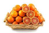 Fresh orange, organic ripe mandarins, pile of orange, sliced orange in wood basket on white background with clipping path.