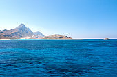The calm sea with a mountain coast in the northwest of Crete.