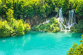 Waterfall at a turquoise lake. The Plitvice Lakes National Park.