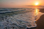 Sunrise at sea on the coast of Crete island, Greece.