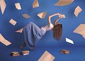 Surreal creative design, levitation. Flying woman. Levity people. Reading girl