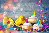 Carnival donuts with paper streamers and party bow tie