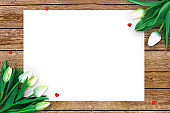Tulips on wooden background with space for message. Mother's Day background. Flowers on rustic table for March 8, International Womens Day, Birthday , Valentines Day or Mothers day - Closeup