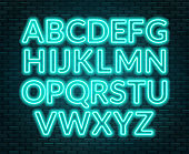 Neon pink alphabet on brick wall background. Capital letter.