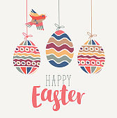 Greeting card with Easter eggs and bird