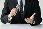 Businessman using microphone
