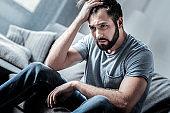 Depressed cheerless man thinking what to do