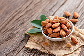 Almonds nut, snack dry nutrition food on wooden background.