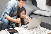 In Selective Focus Of Happy Lover Couple Surprise With Something While Using Laptop Computer Shopping And Winning Gamble Casino Online