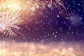 Gold and blue Fireworks and bokeh in New Year. Abstract background winter holiday.