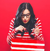 Young woman holding a shopping bag