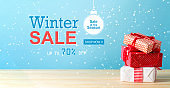 Winter sale message with Christmas gift boxes