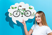 Eco Bicycle with woman holding a speech bubble