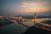 Bhumibol Bridge also known as the Industrial Ring Road Bridge is part of the Industrial Ring Road connecting southern Bangkok with Samut Prakan Province in Thailand.