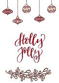 Christmas and New year card with Christmas tree decorations, mistletoe and calligraphy design of phrase Holly Jolly