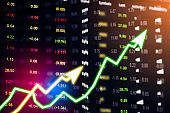showing the Trading graph over the Abstract blurred photo, Business graph and trade monitor of Investment Futures market, app interface is to trade stocks, currencies. stock broker tool.