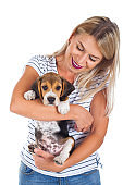 Woman holding beagle baby