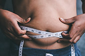 The boys with the waist line want to lose weight.
