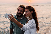 Young couple taking a selfie at the beach