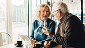 Old couple holding credit card