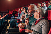 Couple having a snack at cinema