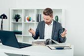 Confused businessman reading paperwork