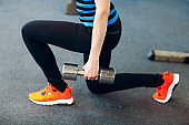 Woman doing lunges in gym.
