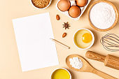 Ingredients and utensils for baking on a pastel background