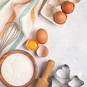 Ingredients for baking  - flour, wooden spoon, rolling pin, eggs.