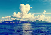 cloud in shape of heart over the island in sea, Sunny summer weather, Greece, Aegean