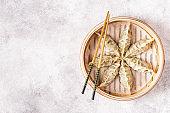 Asian dumplings, soy sauce, chopsticks