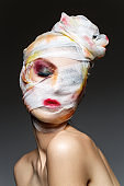 girl with heavy makeup and bandage on head