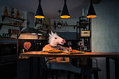 Funny unicorn dinning alone