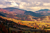 autumn countryside in mountains in red sunset