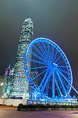 Ferris wheel and skyscraper in Hong Kong city
