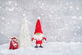 Christmas greeting card. Santa Claus background with Christmas tree and snow. Copy space