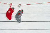 Colorful Christmas socks on white wooden background. Copy space.