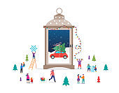 Merry Christmas, Winter wonderland scene in a snow globe, candle lantern, and small people, young men and women, families having fun in snow