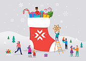 Merry Christmas, winter scene with a big red sock with gift boxes and small people, young men and women, families having fun in snow, skiing, snowboarding, sledding, ice skating