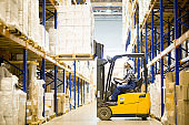 Warehouse driver operating forklift