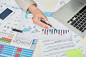 Financial expert analyzing graphs
