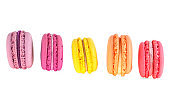 Colourful french macaroons on a white background