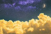 dreamy cloudscape at night with moonlight and stars
