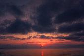dark cloudscape sunset over the sea