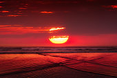red sunset with big sun over the sea
