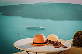 two hats on Santorini island, honeymoon and Greece vacation