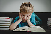 little boy bored tired stressed of reading books