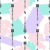 Vector seamless pattern with tribal arrows, triangles and brush painted elements. Boho style