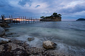 View from Agios Sostis and Cameo island with wooden bridge shot before sunrise . Zakynthos Greece