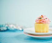 Pastel cupcake with silver bokeh